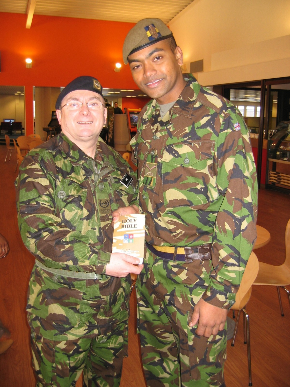 Johnson Beharry VC receiving a replacement NIV Bible (He lost his original in battle)