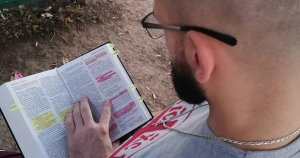 Pedja reading the New Serbian Translation Bible