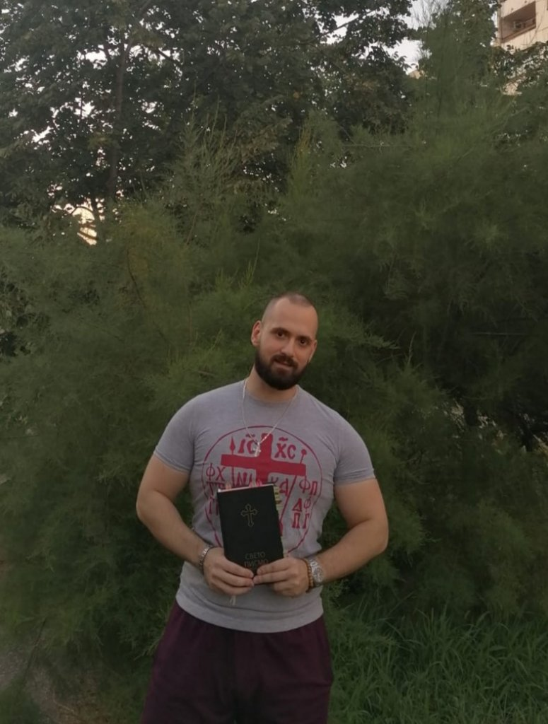 Pedja holding his Pedja reading the New Serbian Translation Bible